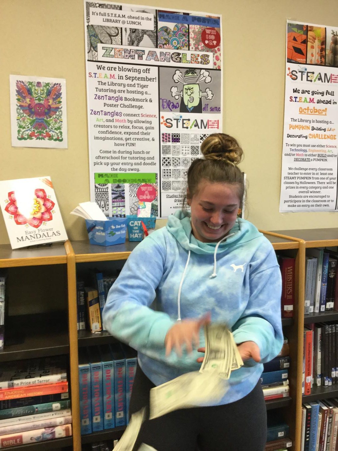 Junior, Stormi Ward throwing her cash prize for winning Septembers theme; zentangle designing.
