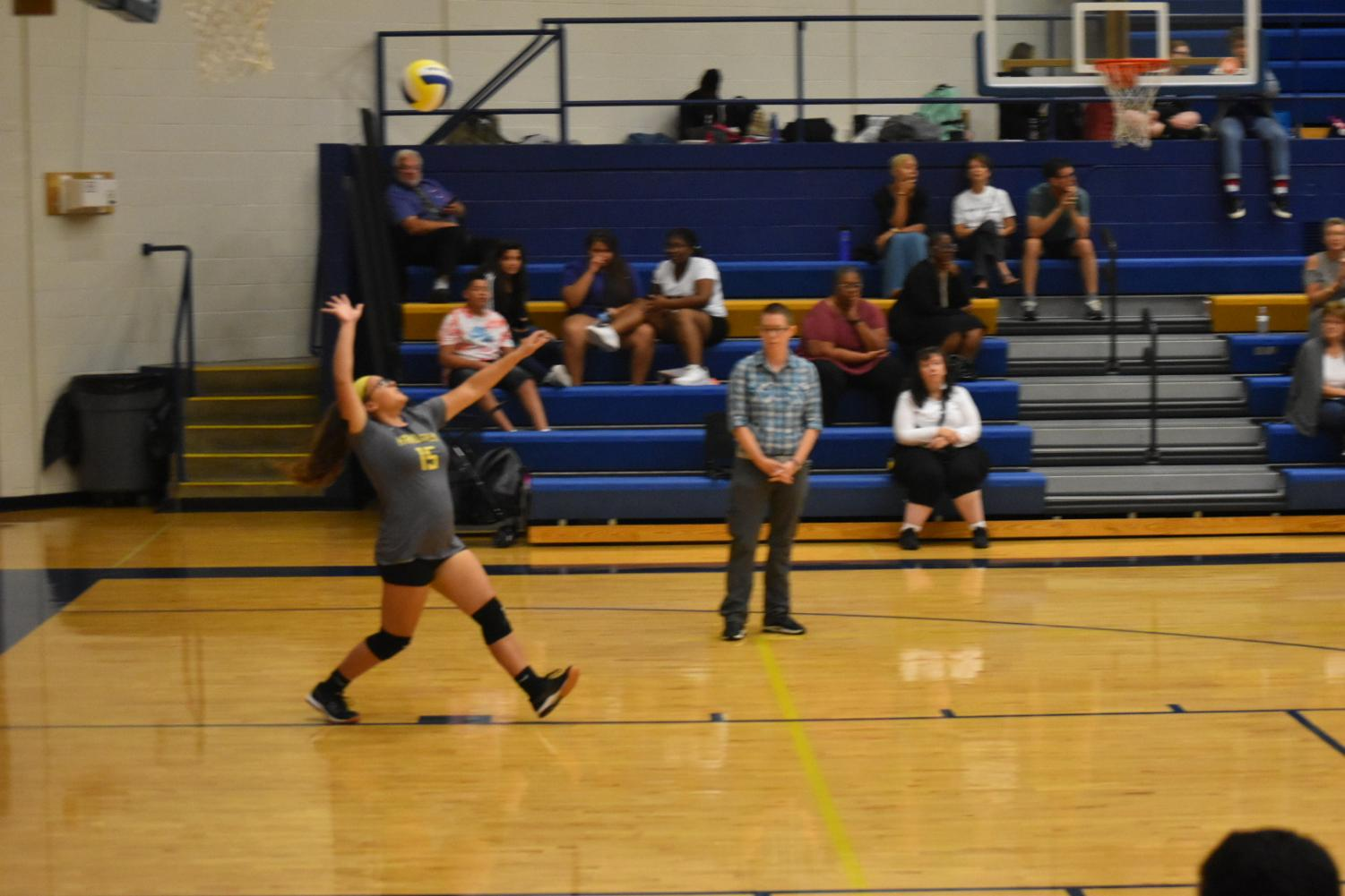 Ashley Matamoros (9) serves the ball against Crossroads College Prep on September 24th.