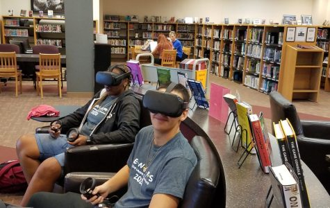 Mariah Stewart(12) and James Anderson(12) explore the VR headsets