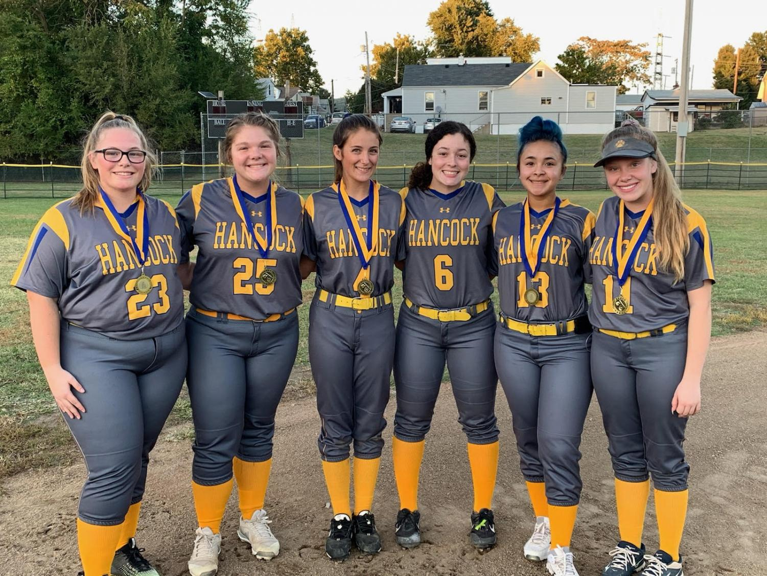 The Seniors from left to right,  Natalie Vineyard, Christine Vineyard, Julie Howard, Jayla Coleman, Gaby Santiago, and Kelly Tyra, pose after their last home game after playing against Metro HS