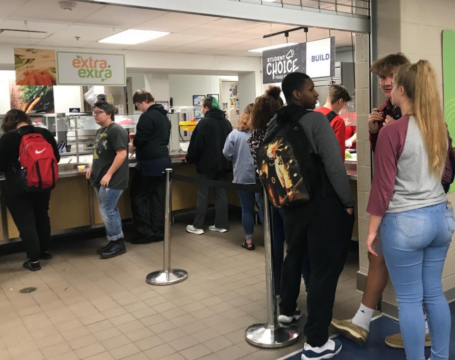 Students stand in line for lunch