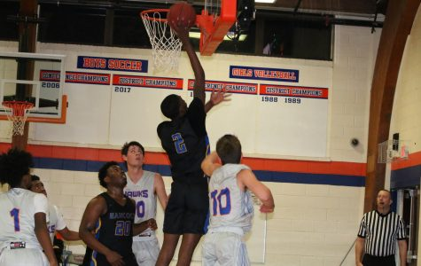 Sam Richardson dunking at game vs Maplewood  Richmond Heights