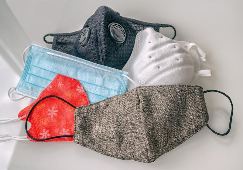 Here a variety of masks are shown. These include a regular cloth masks, a N95 mask, a ventilated mask, and a surgical mask.